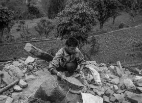 A youth from Tandrang VDC helps to recover the paddy from a collapsed house of Sangam Lamichhane at Gorkha. The first priority for the villagers to recover from the collapsed house was paddy.