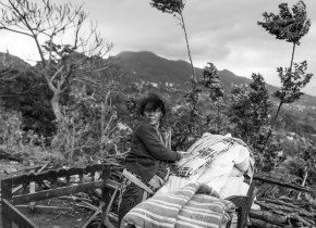 Lal Maya Basnet piles up her belongings she recovered from her destroyed house at Paslang village of Gorkha district. The dark cloud, in the background, added rain to add more pain to the victims of earthquake in Gorkha.