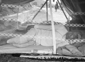 Purna Prasad Shrestha, 70, takes rest at his temporary shelter at Gorkha Bazaar as aftershock keeps on hitting Gorkha District after the main quake.