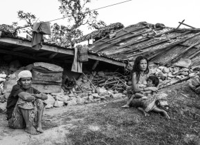 Som Maya Nepali, 76 with her Granddaughter in-law, Susmita Nepali, 25, feeding her baby sit in front of their totally collapsed house in Koplang VDC in Gorkha. They lost their two family members in the earthquake.