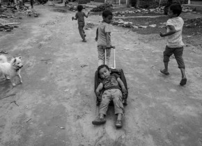 Children from Arughat, Gorkha play with the suitcase found in the debris created by the earthquake . Most of the houses are collapsed in Arughat
