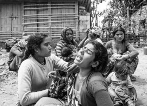 Madina Khatun, 25, mourns on the death of her mother Rabira Bibimiya, 60, due to the earthquake. Mother was buried inside the house as the earthquake hit the village of Asharang VDC in Gorkha.