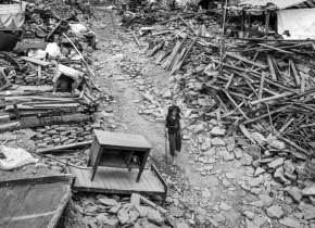 Jhuthi Maya Gurung, 82 years, walks on the debris of Simjung village at Simjung VDC in Gorkha. Simjung Village is face to face with Barpak village which is epicenter of the devastating earthquake. The some kind of devastation can be seen in Simjung Village too.